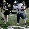 Peabody: Bishop Fenwick's Tyler Thomann pushes Swampscott's (there was no roster) off the field during yesterday's game at Fenwick. Photo by Deborah Parker/Salem News Friday, October 17, 2008.