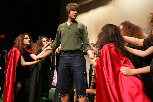 Vernon West, center, who plays John the Witch Boy, along with several cast members of the Dark of the Moon, rehearse a scene at Peabody High School Thursday afternoon. Dark of the Moon is a dramatic stage play in the vein of Romeo and Juliet set in the Appalachian Mountains.  The play centers around the character of John, a witch boy, played by Vernon West, who seeks to become human after falling in love with a human girl Barbara Allen, played Kiera Dancewicz. <br /> Photo by Deborah Parker/November 19, 2009
