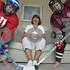 Salem: Hockey mom Pamela Finan has her hands full with two kids playing hockey in two different communities. Her daughter Emily, 11, left plays for Danver's Girls Hockey while her son, Nicholas, 12, plays for Concord Carlisle. Photo by Deborah Parker/Salem News Saturday, September 06, 2008