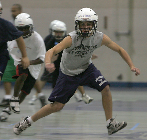 Jake Freedman runs a conditioning drill on the first official day of football practice at Peabody Veterans Memorial High School Monday afternoon. Photo by Deborah Parker/August 23, 2010