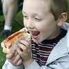 Aidan Stanley, 6, of Danvers licks his lips while enjoying a hot dog at the History, Harmony, Hotdogs & Hits event at Glen Magna Farms as part of Danvers Family Festival Monday evening. The event included an old time baseball game, jazz, hot dogs, root beer floats, and a bouncy house. Photo by Deborah Parker/June 29, 2009