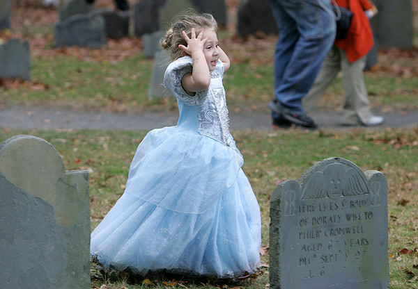Isabelle Weisbaum, 3, of New York runs in between the gravestones at the Burying Point dressed as Cinderella early Halloween evening. Photo by Deborah Parker/October 31, 2009