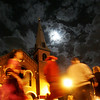 The moon shines on revelers as they walk past the Immaculate Conception Church during Halloween evening Saturday. Photo by Deborah Parker/October 31, 2009