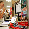 "Neva Payson, 10, of Salem checks out the ""The Weaving Project"" on display at Salem State College. First and second graders at Salstonstall praticiapted in the project, funded by a grant from the Salem Education Foundation. An opening reception was held at Salem State College Monday evening. Photo by Deborah Parker/May 3, 2010"