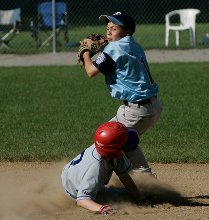 Danvers American Brendan Mackey slides straight into Peabody American second baseman Ryan Collins during Sunday afternoon's District 15 Little League All-Star game. Photo by Deborah Parker/July 5, 2009.