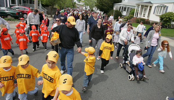 Salem Little League teams walk together down Forest Street during the Annual Salem Little League Parade Sunday morning. Starting at Salem State College, the parade crossed Lafayette Street and ended at Forest River Park. Photo by Deborah Parker/April 25, 2010