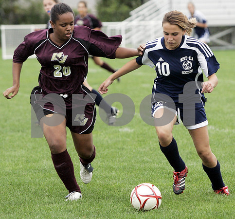 Middleton: Mystic Valley's Mimi Hillaire and North Shore Tech's Jessica Ventrillo fight for control of the ball during their game held at North Shore Technical School Friday evening. As of the first period the Bulldogs lead 1-0.<br />  This is the first time North Shore Tech has had a girls team and second game of the season.<br /> Photo by Deborah Parker/Salem News Friday, September 12, 2008