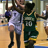 Danvers' Allison Tivnan is defended in front of the net by Lynn Classical's Diamond Doe during last night's Division 2 North girls basketball firt round playoff game held at Danvers High School. Photo by Deborah Parker/February 24, 2010
