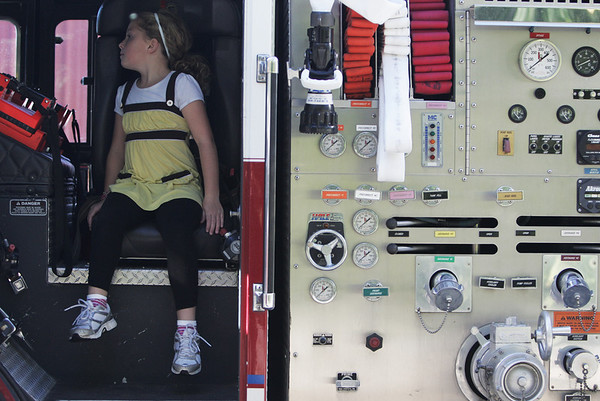 Lillian Tabor, 6, of Ipswich, examines the inside of a fire truck while at the Ipswich Fire Station during their open house Saturday morning. Photo by Deborah Parker/October 9, 2010