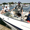 From left, Linda and Stephen Soffron of Marblehead, along with their son Brandon Savage of Wilmington and his daughter, Hannah, 9, get ready for a day out on the boat while at Pope's Landing public dock in Danvers yesterday afternoon. Photo by Debrah Parker/September 4, 2009