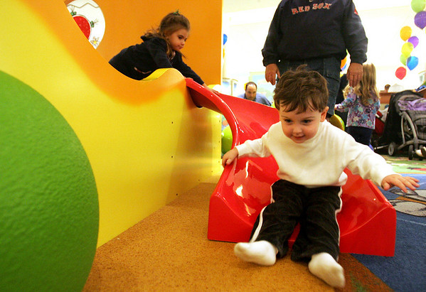 Jackson Haugh, 3, of Stoneham plays on the slide in the new Children's Area in front of the Macy's Men's and Furniture wing at the North Shore Mall Saturday during the new play area's grand opening.  Photo by Deborah Parker/November 14, 2009