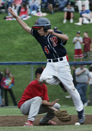 Peabody West's Travis Briana's foot touches the ball for an out despite his best effort during Friday night's game against North Andover held at Wyoma Field in Lynn. Photo by Deborah Parker/July 24, 2009