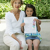 Julianne LeBlanc, 8, of Peabody, a second grader at Brown Elementary School sits with her second grade teacher, Susan Anapolski and holds a poem she wrote in class. The poem won third place in a poety-art show. Photo by Deborah Parker/May 6, 2010