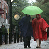 Bill Meis and Courtney Tobey from Brooklyn huddle together under their umbrella while visiting Salem on their vacation Monday evening. Photo by Deborah parker/august 23, 2010