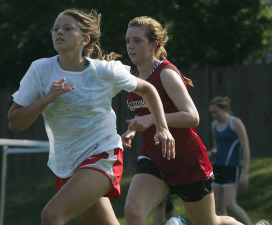 Marblehead field hockey players Gretchen Rowe and Courtney Maher run sprint drills during practice at Seaside Park in Marblehead Thursday afternoon .phoot by deborah parker/september 2, 2010