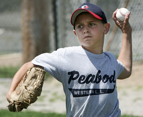 Peabody West's Matt Correale works on a throwing drill at the teams practice at Cy Tenney field yesterday afternoon. Photo by Deborah Parker/July 28, 2009