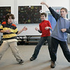 Salem: From left, Saltonstall School students Isaac Vural, Derek Ramsey and Troy Welling, warm up during dance class taught by Carl Thomsen as part of the special legends program at the school. The students were learning a dance to a song about the midnight ride of Paul Revere. Photo by Deborah Parker/Salem News Wednesday, January 14, 2009