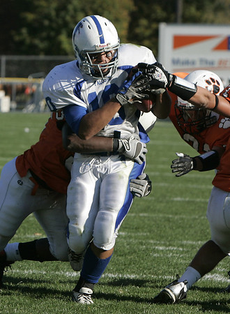 Beverly : Danvers' Eric Burgos is brought down just short of the endzone by Beverly during Saturday's game at Hurd Stadium. Photo by Deborah Parker/Salem News Saturday, October 18, 2008