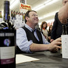 Peabody: Actor Dan Aykroyd smiles up at a fan while signing bottles of his new wine at Kappy's Liquors Friday afternoon. Photo by Deborah Parker/Salem News Friday, February 27, 2009.