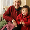 Ginny McGlynn, the longtime owner of Abbott Yarn Shop, has created a pattern for others to use from a scarf that her grandmother knit in the late 1800's. A story on her will be featured in Piecework Magazine next month. She is seen here with her grand daugther, Anna Hollesen, 2.  Photo by Deborah Parker/February 17, 2010