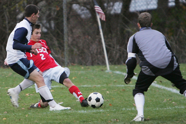Masco's Chad Burke tries to score on goal against Peabody's Corey Cronin during Monday's game held at Peabody. Photo by Deborah Parker/November 2, 2009