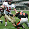 Gloucester's #32 pushes his way past Beverly's Dylan Terry during yesterday's game held at Hurd Stadium. Photo by Deborah Parker/October 4, 2009