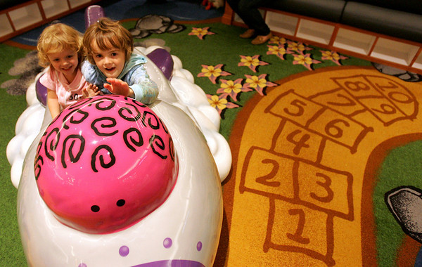 Madison Flaherty, 5, left and her sister Anna, 2, of Lynn play in the new Children's area in front of the Macy's Men's and Furniture wing at the North Shore Mall Saturday during the new play area's grand opening.  Photo by Deborah Parker/November 14, 2009