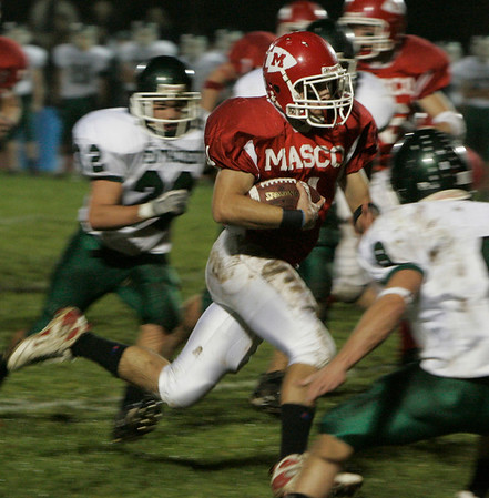 Boxford: Masconomet's Chris Splinter runs through Pentucket's defensive line during last night's game held at Masco. Photo by Deborah Parker/Salem News Friday, November 7, 2008.