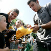 "Boston Bruins left wing, Milan Lucic, signs the hat of Bruins fan Tyler Fawcett, 5, of Peabody before the start of Boston Bruins Foundation's ""Swing Like Happy Gilmore Long Drive Contest"" held at Golf Country in Middleton Tuesday.  Photo by Deborah Parker/September 1, 2009"
