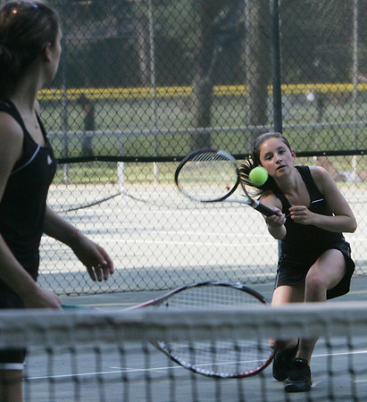 Ipswich's Katelyn Kelley, left, and Megan Freiberger compete in yesterday's doubles tennis match against Hamilton Wenham. Photo by Deborah Parker/May 26, 2010