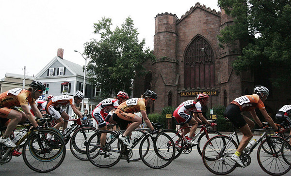 Competitors in the women's race of the Witches Cup Road Race in Salem pass the Salem Witch Museum around Salem Common during the race on Wednesday. Photo by Deborah Parker/August 12, 2009