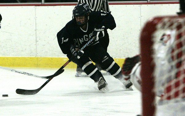 Wenham: Pingree's Kaitlyn O'Connell looks to score on Masconomet  during the Pingree Holiday Tournament held at Johnson Rink Saturday. <br /> Photo by Deborah Parker/Salem News Saturday, December 13, 2008