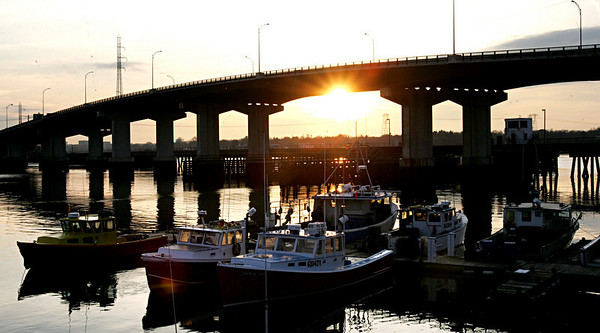 The sun shines through the Veterans Memorial Bridge late Tuesday afternoon. Photo Deborah Parker/December 15, 2009