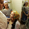 Sylvie Miller of Waltham who plays a Chava in Neverland Theatre's production of Fiddler on the Roof, works on the costume of cast member Lucy Twombly, 7, of Rockport who plays Anya during dress rehearsal Tuesday evening. The production will take place Saturday March 20 through Tuesday March 23, at Temple B'nai Abraham in Beverly.  In the background is Twombly's sister Kristen, 9, who places Shprintze. Photo by Deborah Parker/March 16, 2010