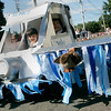 "Peter Coluntino, 10, left, of Beverly and Ralph Coluntino, 13, ride in a float honoring Capt. C.B. ""Sully"" Sullenberger who made an emergency landing in the Hudson River during Beverly Farms annual Horribles Parade Saturday. Photo by Deborah Parker/July 4, 2009"