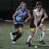 Bishop Fenwick's Colleen Sears is defended by Medfield's Stephanie Buff during yesteday's game under the lights held at Bishop Fenwick in Peabody. Photo by Deborah Parker/october 18, 2010