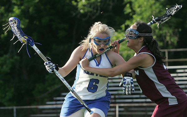 Danvers' Kathleen Landers is defended by Weston's  Abby D'Angelo during yesterday's Division 2 North state tournament quarterfinal held at Deering Stadium in Danvers Monday evening. Photo by Deborah Parker/June 7, 2010