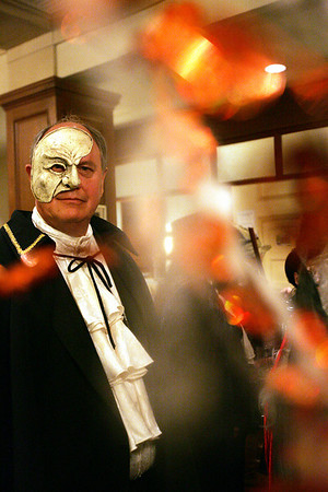 Jim Klump of New Mexico strikes a pose at the Phantom of the Opera while waiting in line to enter the Witches's Ball at the Hawthorne Hotel Friday evening. Klump is visiting the area to learn more about his relative Mary Walcott who was involved in the Salem witch histeria. Photo by Deborah Parker/October 30, 2009