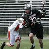 Beverly: Marblehead's Hunter Whitemore is defended by Beverly's Jeff Hutchinson during yesterday's game held at Hurd Stadium. Photo by Deborah Parker/May 15, 2009