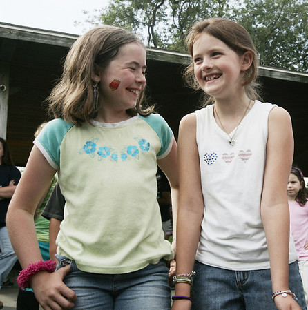 Saltonstall School classmates, Patty Roberts, 9, left, and Neva Payson, 9, both of Salem dance and sing to a song by Taylor Swift during the school's picnic at Winter Island yesterdy evening. Photo by Deborah Parker/July 22, 2009