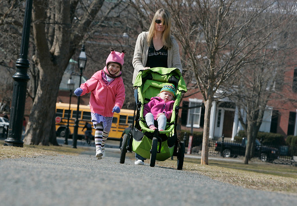 Salem: Matilda Nordensved, 4, runs along side the carriage while out walking in Salem Commons with her mom, Nicole and sister Linnea, 2, Wednesday afternoon.<br /> Photo by Deborah Parker/Salem News Wednesday March 18, 2009.