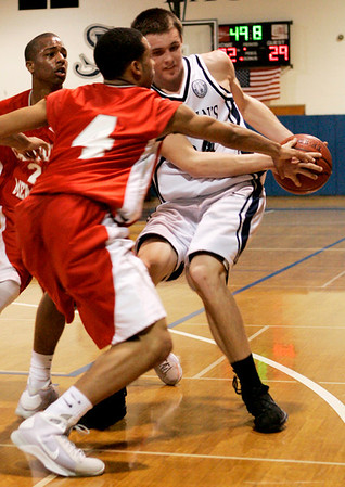 Danvers: Catholic Memorial's Kyle Lawrence defends the hoop against St. John's Patrick Connaughton during yesterday's game held at St. John's. Photo by Deborah Parker/Salem News Friday, January 16, 2009.