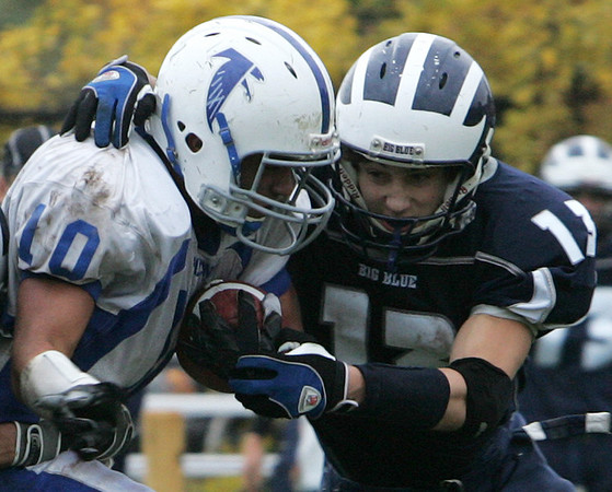 Swampscott's Michael Walsh attempts to tackle Danvers' Harry Prunier during Saturday's game held at Swampscott. Photo by Deborah Parker/October 24, 2009