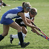 Danvers' Sara Perry fights for control of the ball against Beverly's Corinne Woods during yesterday's game held at Beverly High School. Photo by Deborah Parker/September 10, 2009