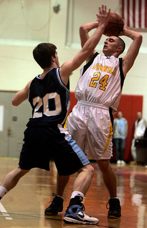 Chelsea: Bishop Fenwick's Nick Cotoiais defended near the hoop by Wilmington's Craig Melillo during last night's Division 3 North semifinals game at Chelsea High School. Photo by Deborah Parker/Salem News Thursday, March 5, 2009.