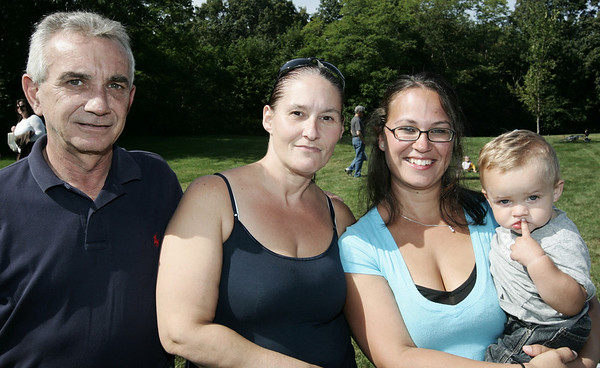 From left, neighbors, Rich Armstrong, Liz Douglass, and Christina Muse holding Anthony muse, all of Peabody, pose together while watching the North Shore Oldtimers againts Peabody Police Department baseball game to benefit Jimmy Fund. Photo by Deborah Parker/September 7, 2009