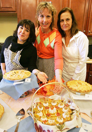 From left, Gayel Cote of Landmark at Oceanview Assisted Living, Kathy MacNeill of The Girdler House and Nancy Loving of Essex Park Rehabilitation and Nursing Center pose with some of the pies that were judged yesterday at Essex Park's Annual Fall Pie Baking Contest. Photo by Deborah Parker/November 17, 2009