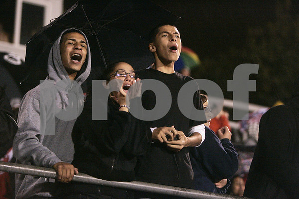 Salem: Salem High School sophomores from left, Alan Maldonado, Amber Fernandes and Edward Vincente cheer on the Witches as they played Danvers last night at Betram Field for the their first game of the season. Photo by Deborah Parker/Salem News Friday, September 12, 2008