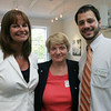 From left, Nancy Furnari and Anna Kulakowski, both of Danversbank along with Ben Bouchard from the Salem Chamber of Commerce, attend Coffee Connection, a Chamber event, held at Kim Indresano Photography in downtown Salem Thursday morning. Photo by Deborah Parker/July 8, 2010