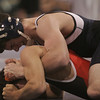 St. John's Doug Harding wrestles with Agawam's Vinny Derose during their match held at St. John's Prep in Danvers Saturday morning. photo by deborah parker/december 18, 2010